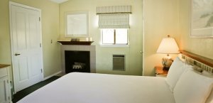 Bed with fireplace, lamp and window