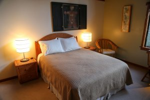 bed with bedside lamps