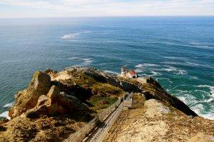 light house by ocean cliffside