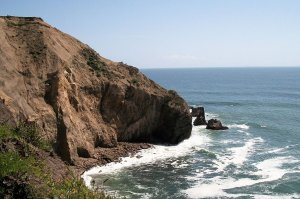 rocky cliff and ocean waves