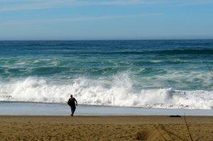 man watching ocean waves