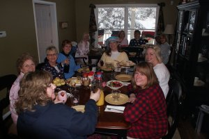 Room full of ladies at the breakfast table