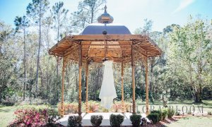 wedding dress hanging from gazebo