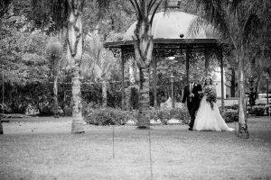 bride and groom by gazebo