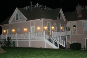 Exterior of the Inn at night with lights shining