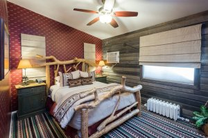 Western themed bedroom with log bed