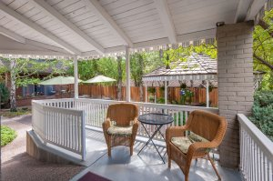 Backyard porch and wicker chairs