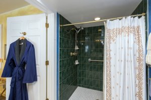 tile standing shower and shower curtain