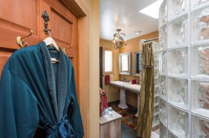 hanging bathrobe and glass bathroom shower