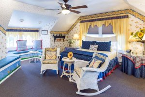 blue bedspread and wicker rocking chairs
