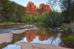 water reflecting rock columns