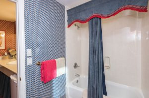 tub shower combo with blue curtain