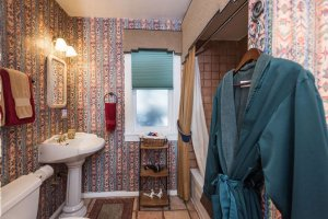 sink and shower with native american wallpaper