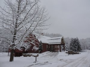 The Barn Inn covered in snow during the winter
