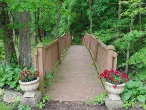 A wooden bridge extending over a creek
