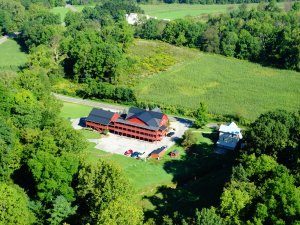 a high aerial view of the Barn Inn and its property