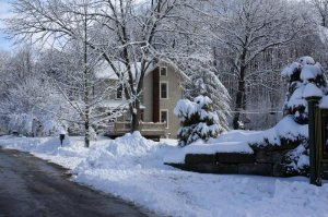 the Farmhouse covered in snow