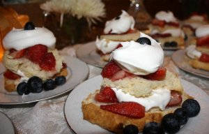 Breakfast pastries piled with fruit and whipped cream