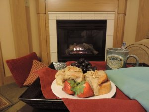 cinnamon rolls and strawberries by the fireplace