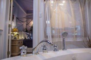 Hines Mansion Seaside Retreat Room bed through door of bathroom