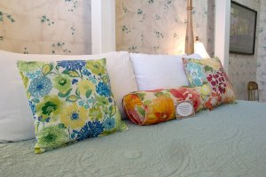 Hines Mansion Secret Garden Room pillows on bed