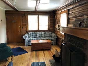 sitting area with fireplace in cabin 4