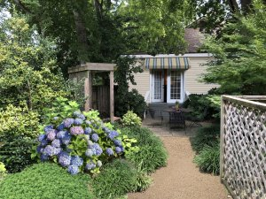 Hayward Cottage garden with seating and entrance