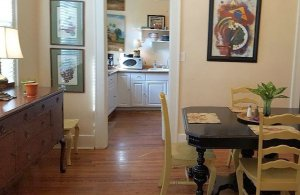 Dining room off kitchen with table & six chairs