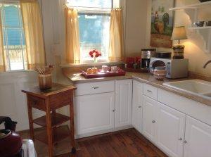 Full kitchen with window to garden