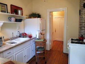 Kitchen with full size fridge, stoe & oven