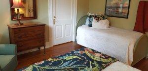 Single bed in large queen bedroom