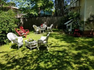 Barkley Cottage fenced garden with seating