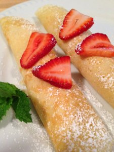 Rolled crepes with strawberries