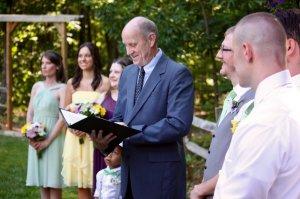 A man reading wedding vows