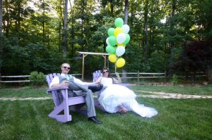 Bride and groom in adjacent rocking chairs