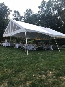 A canopy and chairs set up for a wedding