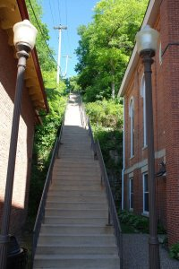 A tall stairway between two brick buildings