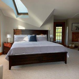 balcony door with bed and nightstand