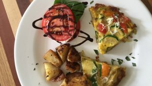 quiche, potatoes with caprese side