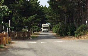 An RV driving down a road inside the resort