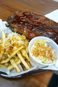 Barbecue meat, fries, and cole slaw