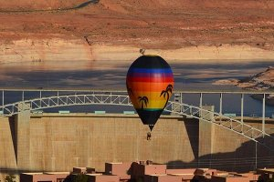 Hot air balloon near a dam
