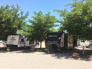 Moab Rim Campark RV Sites camper trailers trees