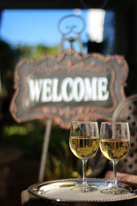 Wine glasses near a welcome sign