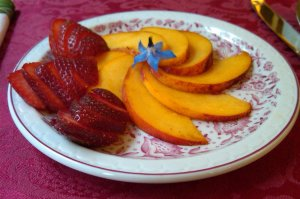 Peaches and strawberries on a plate