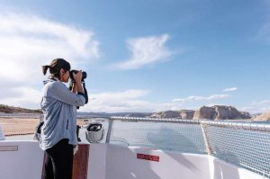 tourist taking photo of lake powell