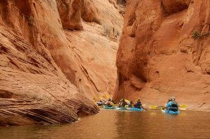 tourists kayaking in canyon