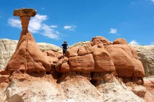 man standing along the toadstool hoodoos