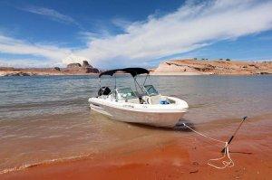 19' Open-bow Ski Boat anchored on shore