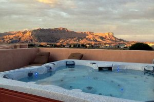view of surrounding mountains and lake powell from rooftop sundeck with hot tub